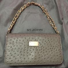 St. John Clutch Brand new St. John clutch with removable gold straps. Still has dust bag and seal on logo. Zipper and card slots and pockets inside St. John Bags Clutches & Wristlets