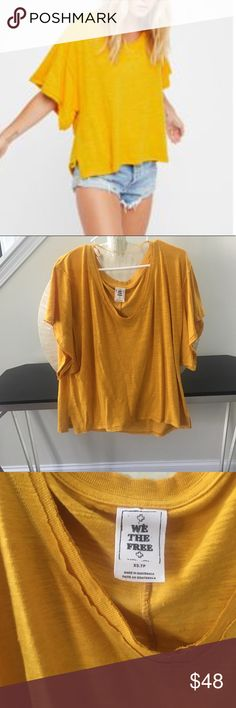 Free People we the free my boyfriends tee yellow NWOT. Brand new and never worn. 100% cotton. Gorgeous mustard yellow oversized FP tee. Thanks for looking and make an offer.💕 Free People Tops Tees - Short Sleeve