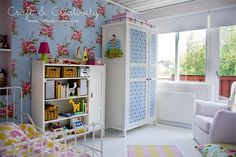 Sweet Cottage Toddler Room  - There is something I really love about this vintage floral wallpaper. I really don't like that bedding or the armoir.