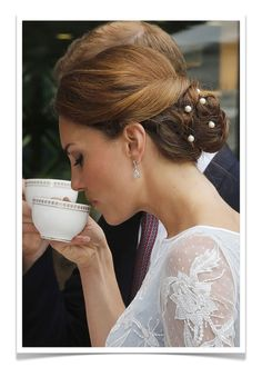 Kate Middleon, Duchess of Cambridge, wearing a chignon with pearl hair pins