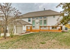 """$190,000 - Great space in this """"everything been done for you"""" house! Big fenced lot, HUGE Garage (24x30), GIANT workshop/hobby room (15x30), NEW(ER) siding, windows, roof, hvac, pool, fence, carpet, custom decks..see SD list, 7 minutes to I-70. Hot tub in covered gazebo, backs to park, finished bsmt w/ Fam Rm, """"non conf"""" 4th BR, full bath.  http://searchallproperties.com/listings/1327234/3120-N-157-Terrace-Basehor-KS  Listing Provided Courtesy of Reec & Nichols West"""