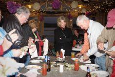 Who doesn't like a fun oyster roast?     Absolutely Charleston social event on Bowens Island!     MG Photography LLC #absocharleston