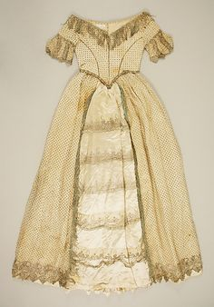 White cotton and silk satin evening dress with metallic-thread embroidery and metallic-fringe trim, American, ca. 1840.