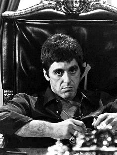 Scarface. Great poster. Lousy movie. Watch it again and say it's great. Betcha can't.