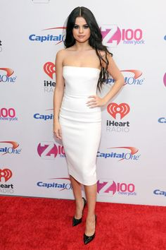 Selena Gomez wears a strapless white Victoria Beckham dress and black pointy pumps at Jingle Ball 2015 in New York City.