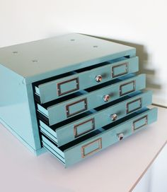 turquoise vintage drawers on etsy. too bad shipping is $70, gah.