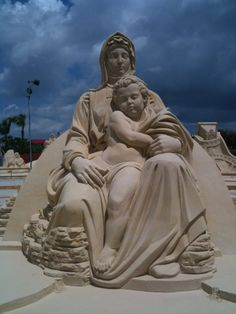 Mother and child amazing sand sculpture.