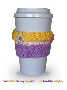 A cute and fun handmade crochet Rapunzel coffee cup cozy! Rapunzels long braid is decorated with tiny crocheted flowers and wraps around the