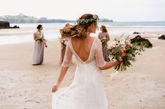 Charlee and Luke's gorgeous Cornish beach wedding. Charlee had flowers to reflect the seascape, with a crown of sea holly, jasmine and foliage. Buttonholes to match and Bouquets of summer roses, dahlia's and jasmine. With thanks to Paul Fox from Albion Row photography.