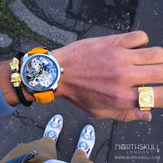 Fan Instagram Pic ! | @sbatra69 posted a cool photo of his Tissot T-Complication Squelette Watch nicely paired with our luxurious Black Nappa Leather & Gold Twin Skull Bracelet. The look is finished nicely with our Kinetic Ring in Gold. Great combo ! | Available now at Northskull.com | For a chance to get featured post a cool photo of your Northskull jewelry with the tag #Northskullfanpic on Instagram