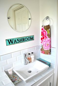 Love the mirror and pops of vintage colour