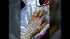 Sparkling white henna designs by Nay henna Art made step by step until f...