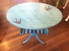 small side table painted in APC Beach Glass with stripes and swallows hand painted in Lincolns Hat
