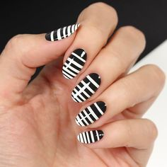 I love a good monochrome design! I decided to do simple black and white stripes with descending sizes that go all the way down the nail. Go vote for this design during the @nailchamp competition by clicking the link in my bio or checking out nailchamp.com! ✨💅🏼✨ #nailchamp #sponsored