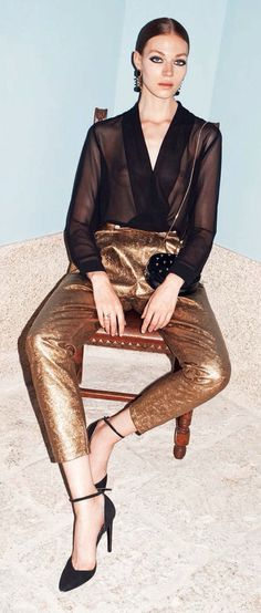 Gold pants and sexy blouse