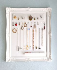 DIY Simple Frame Jewelry Holder by Monaluna (I love the catch-all dish at the bottom!)