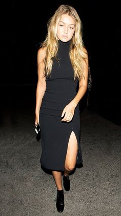 Gigi looked stunning in a black turtleneck sleeveless dress and black booties.