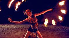 Fire dancing duet. Poi and fire fans