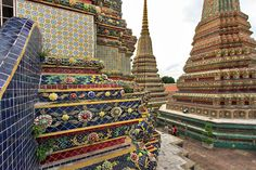 Beautiful Mosaic Artistry ~ Ceramic decorated Stupas at Wat Pho, Bangkok ~ Photo by Barbara Weibel, www.holeinthedonut.com