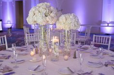 Modern White Centerpieces  // photo by  Carrie Wildes Photography