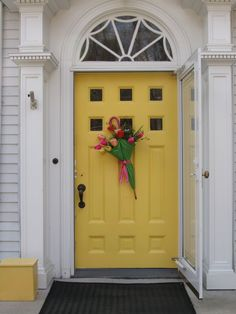 tulips in an umbrella--must do this--and paint the front door yellow!