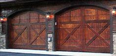 Love these rustic barn doors as garage doors!
