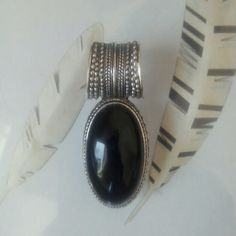 """Silver and black pendant Oval black """"stone"""" cabochon set in silvertone. Jewelry Necklaces"""