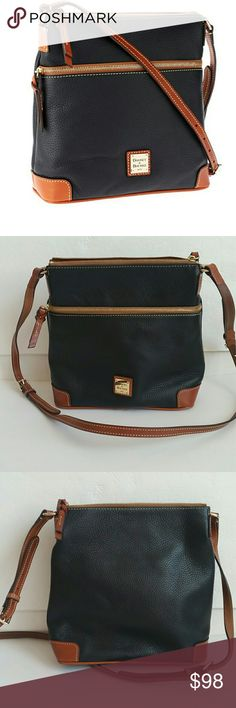 """Dooney & Bourke Pebble Leather Crossbody Preown..in great condition. Has a little wear  on the bottom side. But super small. I've taken pictures of it above. Comes with  dust bag. Pebble finish, adjustable crossbody strap, top zip closure, front zip pocket, metal logo plate Lined interior, two front-wall slip pockets, back-wall slip pocket, back-wall zip pocket, key keeper Measures approximately 10-1/4""""W x 10-1/2""""H x 4""""D with a 23"""" to 26"""" strap drop; weighs approximately 1 lb, 6 oz Body/trim…"""