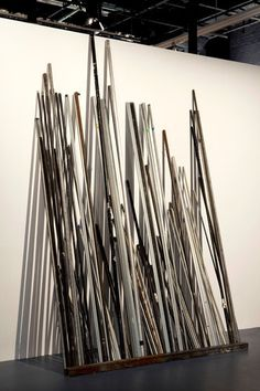 A collection of scavenged pipes arranged by Virginia Overton