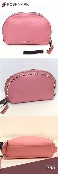 "REBECCA MINKOFF LARGE Dome Pouch  With Studs Guava Guaranteed Authentic! Rebecca Minkoff LARGE dome pouch with studs. Amazing color: Guava and silver tone hardware. Genuine leather. Ideal for storing your makeup and other essentials, this compact pouch stands on its own. Zipper closure. Interior in black lining, and 1 zip pocket. Measurement: 7""H x 3.25""W x 10.5""L. Item will be videotaped prior to shipping to ensure proof of condition. Rebecca Minkoff Bags Cosmetic Bags & Cases"