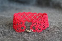 Red lace bracelet. My Granny tried and tried to teach us all how to tat. Wish I were better at it!