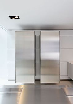 B3 Sculptured Cube pantries in stainless steel and walnut by Bulthaup. 800-808-2923; bulthaup.com.