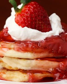 Servings: 4-6IngredientsStrawberry Syrup:2 cups strawberries, quartered1 cup water1 cup sugar 1 tablespoon cornstarch, optional1 tablespoon water, optional Buttermilk Pancakes:1 egg 3 tablespoons butter, melted 1½ cups buttermilk 1½ cups all-purpose flour 2 tablespoons sugar 1 teaspoon baking powder 1 teaspoon baking soda ⅛ teaspoon salt ButterWhipped cream, optional PREPARATIONIn a saucepan over medium heat, add the quartered strawberries, water, and sugar. Stir until combined and bring to…