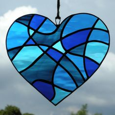 Stained Glass suncatcher Abstract Love Heart in four shades of blue rippling waterglass Stained Glass Crafts, Stained Glass Designs, Stained Glass Panels, Stained Glass Patterns, Mosaic Glass, Fused Glass, Himmelblau, Colored Glass, Cobalt Blue