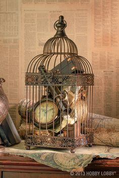 Need a standout piece for a lonely tabletop? Add personal touches, like a group of treasured collectibles, to the birdcage of your choice. For example, we filled one cage with rustic, globetrotter accessories, and we filled another with a hodgepodge of just-because-we-love-them trinkets. Go with items that speak to you—and you'll definitely have others talking. Tip: To help minimize the height of a tall birdcage, hang a pendant or other bauble from the top.