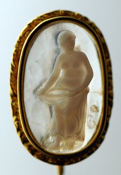 """Aphrodite"", 17th-18th century, agate  libation bowl carved in back of cameo to give bowl transparent look.  Gold cravat pin mount, France, circa 1830-1840"