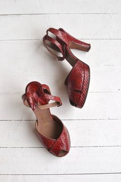 Vintage 1940s deep ruby red snakeskin peeptoe platforms with ankle strap. ✂-----Measurements  fits like: us 6.5 | euro 37 | uk 4.5 insole: 9.5 ball: