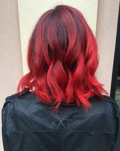 Bright red balayage hair by Rachel at Avante on Main Street Salon, Exton PA