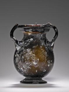 A small jar of free-blown, translucent, amber-colored glass. Roman 3rd - 4th century. Unknown | The J. Paul Getty Museum