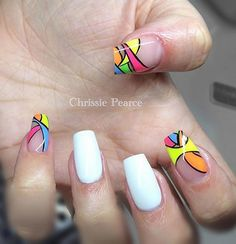 Make the colors of your abstract nail art design pop out by using black polish to highlight the sides of the patterns. Clear polish is used as the base color to make the design stand out even more.
