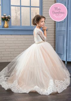 The Fremont little girl wedding dress is designed to make her a star of the ceremony. This princess gown features an illusion lace neckline and sleeves, lace bodice with keyhole back detailing and pea