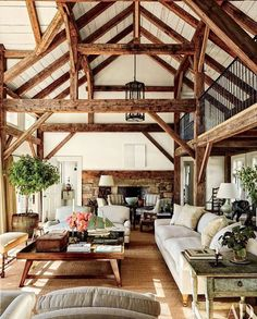 Reclaimed timber beams accent the barnlike common room at Lynn and Sir Evelyn de Rothschild's Martha's Vineyard home, which was built by Rivkin/Weisman Architects and decorated by Mark Cunningham. Perfect example of too much going on. Architectural Digest, Sweet Home, House In The Woods, Home Living Room, Cottage Style Living Room, Living Area, My Dream Home, Dream Homes, Great Rooms