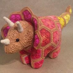 Long extinct, the Triceratops remerges as a lovely African Flower softie. Custom handmade, you too can have your very own triceratops. Private message color preferences. I try to make my African Flower creatures from good quality cotton, sometimes acrylic, bamboo, or wool is used. The size of the triceratops may vary, but he is approximately 17in long, 9.5in tall, and 7in wide.