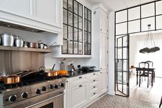 I love the industrial glass panels as an interior wall/doors & kitchen cabinetry.Gorski+Residence+by+FJ+Interior+Design Home Decor Kitchen, Kitchen Living, New Kitchen, Home Kitchens, Sweet Home, Interior Architecture, Interior Design, Interior Office, Bright Kitchens