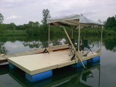 camping houseboat | ... Tom Sawyer raft? I think it looks more like a wooden pontoon boat