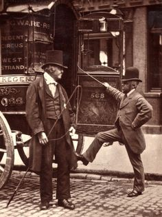 Street life in London, 1876.  Man on the left (with very cool high hat) has horse whip in his hand, so assume he's the carriage driver. Man to the right, maybe an assistant? In any event, it seems like every man at this time period wore a high hat.......which i looooove!!!