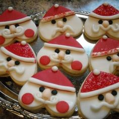 Heart shaped cookie turned upside down & decorated to make cute Santa's