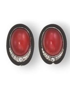 [Earclips Only} A pair of art deco coral and diamond earclips and ring, Marsh & Co, circa 1935 the earclips designed as oval cabochon coral within a blackened steel surround, accentuated by a round brilliant-cut diamond and etched platinum of foliate motif.