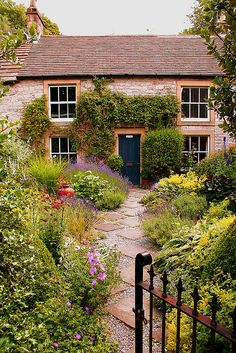an actual cottage with a garden