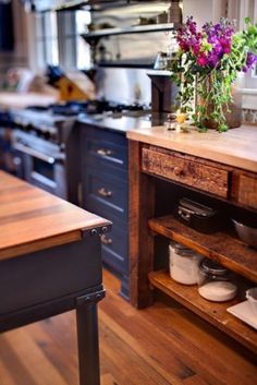 Love the combination of navy blue cabinets and rustic wood tables @istandarddesign
